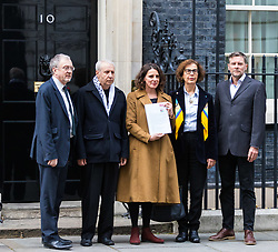 London, November 01 2017.A group from Medical Aid for Palestinians delivers a petition to Downing Street demanding health and dignity for Palestinians with this year marking the 100th anniversary of the Balfour Declaration and 50 years of occupation as well as 10 years of Israel's 'suffocating closure' of Gaza. © Paul Davey