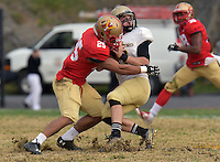 NCAA Football: Wofford overruns VMI, 41-20 - VMI defender Alex Keys (#25) brings down Wofford quarterback Evan Jacks in the second half of Satruday's Southern Conference tilt in Lexington.  Jacks would lead the Terriers over VMI, 41-20, with 19 yards rushing and two TDs.