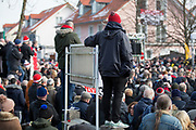 Fans stand on wall during the ceremony at Manchesterplatz, Munich, Germany. Picture by Phil Duncan.