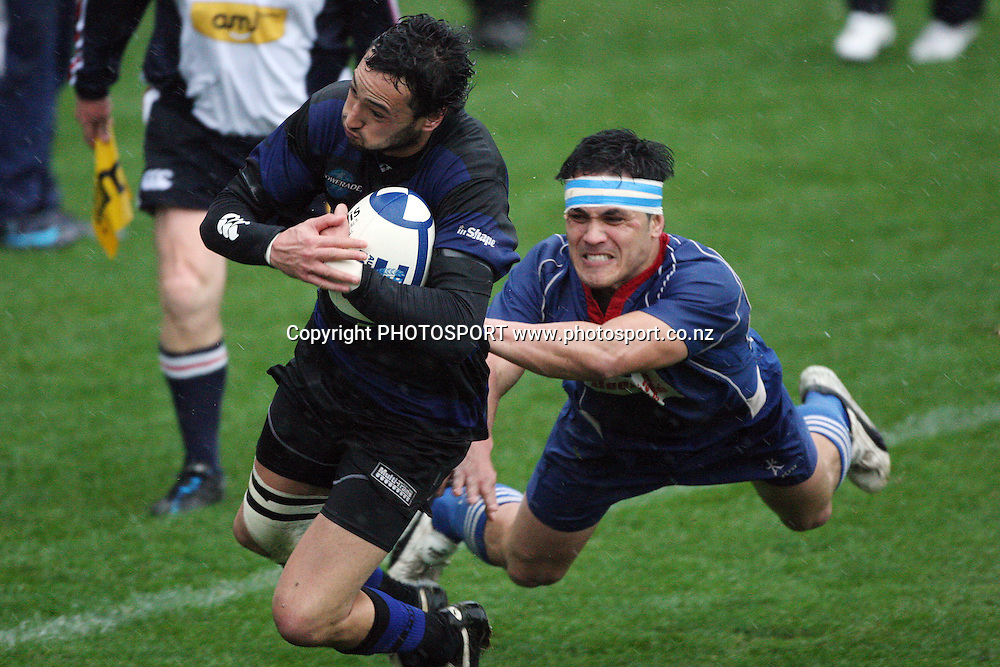 Ponsonby fullback Chay Raui heads for the try line as University winger Pasila Wilson dives in vain. Gallaher Shield, Auckland club rugby final, Ponsonby v University. Eden Park, Auckland. Saturday, 1 August 2009. Photo: Andrew Cornaga/PHOTOSPORT
