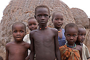 A group of young boys stand outside their Manyata house in the village of Kaikor in Turkana, Northern Kenya.