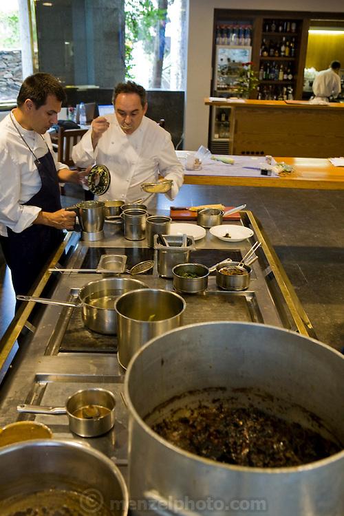 Ferran Adrià, chef of El Bulli restaurant near Rosas on the Costa Brava in Northern Spain taste tests food in the restaurant's kitchen. (Ferran Adrià is featured in the book What I Eat: Around the World in 80 Diets.)