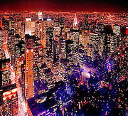 Midtown Manhattan at night from the 86th floor Observation Deck of the Empire State Building. Street at left is Fifth Avenue. The illuminated skyscraper in the background, just right of center, is the Chrysler Building.