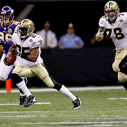 September 9, 2010; New Orleans, LA, USA;  New Orleans Saints running back Reggie Bush (25) runs with the ball during the NFL Kickoff season opener at the Louisiana Superdome. The New Orleans Saints defeated the Minnesota Vikings 14-9.  Mandatory Credit: Derick E. Hingle