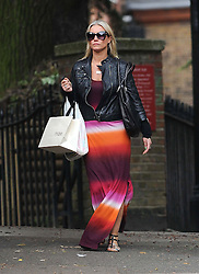 Denise van Outen wearing a black leather jacket, Tie-Dye maxi dress and sandals, out running errands in North London, UK. 11/06/2013<br />