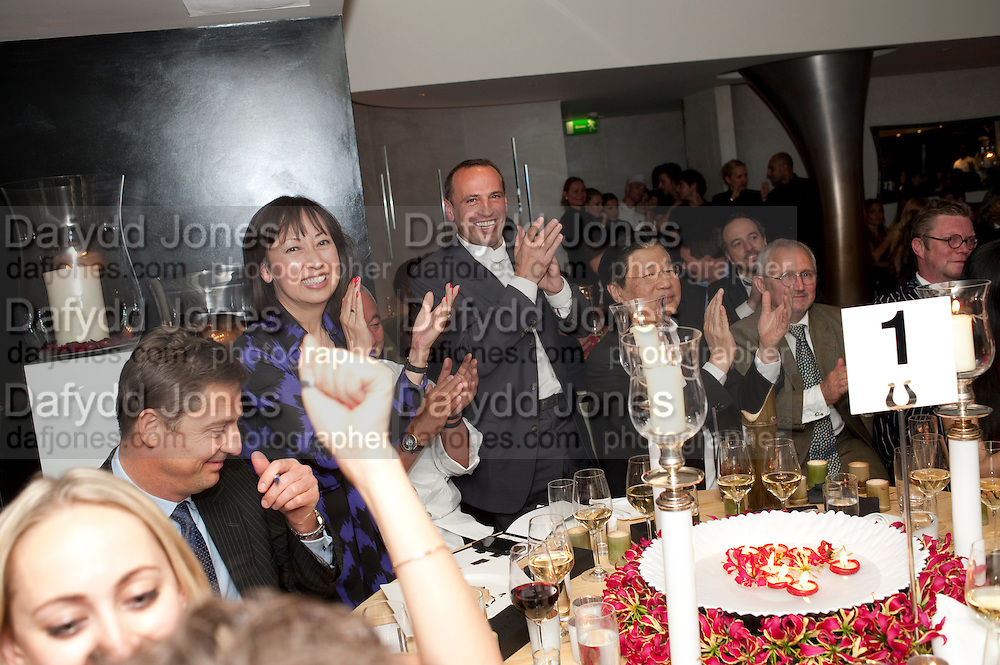 APPLAUSE FOR BIDDING, The Tomodachi ( Friends) Charity Dinner hosted by Chef Nobu Matsuhisa in aid of the Unicef  Japanese Tsunami Appeal. Nobu Berkeley St. London. 5 May 2011. <br /> <br />  , -DO NOT ARCHIVE-© Copyright Photograph by Dafydd Jones. 248 Clapham Rd. London SW9 0PZ. Tel 0207 820 0771. www.dafjones.com.