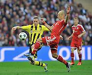 UEFA Champions League final football match between Borussia Dortmund and Bayern Munich at Wembley Stadium in London on May 25, 2013, Bayern Munich won the game 2-1 <br />Arjen Robben of Bayern Munich /L/ and Sven Bender of Borussia Dortmund.<br />(Photo by: Piotr Hawalej)