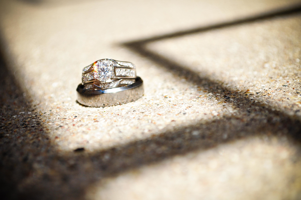 Abby & Matt's wedding rings with shadows at Richland Center, Wisconsin