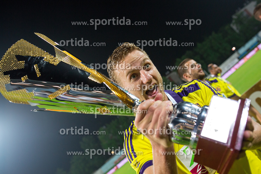 Ales Mertelj with trophy during football match between ND Gorica and NK Maribor at NZS Super Cup of Liga Telekom Slovenije 2014/15, on August 13, 2014 in Sportni Park Nova Gorica, Nova Gorica, Slovenia. Photo by Urban Urbanc / Sportida.com