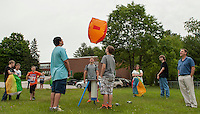 Belmont Middle School students Alex Gilbert, Dakota Wright, Drew Taylor and Bryan Underhill send off their hot air balloon created with tissue paper and rubber cement during 8th grade Science class with Mr. Wright on Monday morning.    (Karen Bobotas/for the Laconia Daily Sun)