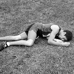Cody Davis, from New Plymouth High School catches his breath after crossing the finish line during the Boys 1A/2A Idaho State Cross Country Championship held at Eagle Island State Park. Davis finished in 52nd place with a time of 18:33.8. Saturday November 1, 2014