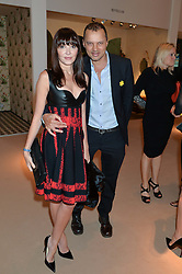 GERRY DEVEAUX and ANNABELLE NEILSON at the Masterpiece Marie Curie Party supported by Jeager-LeCoultre held at the South Grounds of The Royal Hospital Chelsea, London on 30th June 2014.