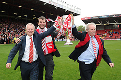 Bristol City's majority shareholder, Steve Lansdown, Vice Chairman, Jon Lansdown and Chairman Keith Dawe walk out with the Sky Bet League One Trophy  - Photo mandatory by-line: Joe Meredith/JMP - Mobile: 07966 386802 - 03/05/2015 - SPORT - Football - Bristol - Ashton Gate - Bristol City v Walsall - Sky Bet League One