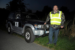 © Licensed to London News Pictures. 03/09/2013. Eldersfield, Gloucestershire, UK. Terry Howard from We Are Change Gloucestershire joins the Wounded Badger Patrol patrol in Gloucestershire.  Around 100 people patrolled local roads and public footpaths looking for injured badgers from the badger cull which has now started in West Gloucestershire.  Police were also patrolling but there were no arrests.  03 September 2013.<br /> Photo credit : Simon Chapman/LNP