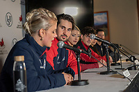 KELOWNA, BC - OCTOBER 26: Ice dance silver medalist Zachary Donohue looks on as his partern Madison Hubbell of the USA speaks to the media at a press conference at Prospera Place on October 25, 2019 in Kelowna, Canada. (Photo by Marissa Baecker/Shoot the Breeze)