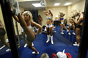 "Baltimore Ravens cheerleader hopefuls warm up before taking to the stage during an event called ""Making the Cut"" to select the 2011 Baltimore Ravens cheerleaders in Baltimore, Maryland, March 26, 2011."