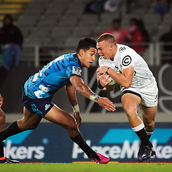 Curwin Bosch beats Blues winger Rieko Ioane during the Super Rugby match between the Blues and Sharks at Eden Park in Auckland, New Zealand on Saturday, 31 March 2018. Photo: Dave Lintott / lintottphoto.co.nz