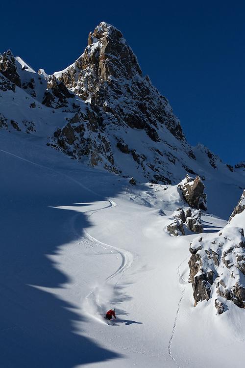Male Skier descends mountainside in fresh Snow. Davos, Switzerland