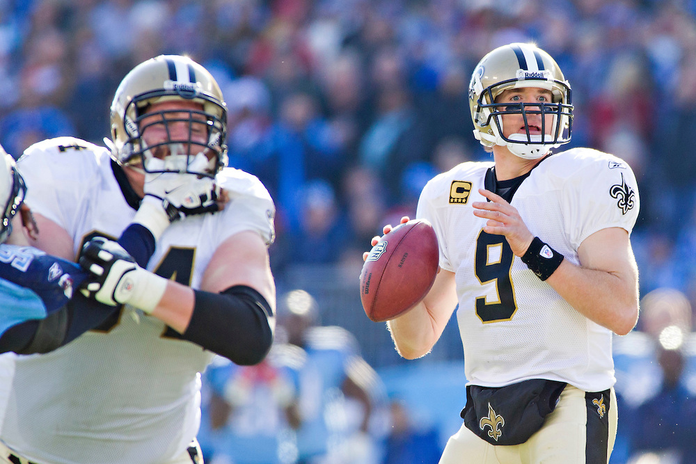 NASHVILLE, TN - DECEMBER 11:   Drew Brees #9 of the New Orleans Saints looks for a receiver against the Tennessee Titans at LP Field on December 11, 2011 in Nashville, Tennessee.  The Saints defeated the Titans 22-17.  (Photo by Wesley Hitt/Getty Images) *** Local Caption *** Drew Brees