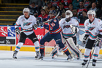 KELOWNA, CANADA - MARCH 5:  Jermaine Loewen #32 of Kamloops Blazers checks Devante Stephens #21 in front of the net of Michael Herringer #30 of Kelowna Rocketson March 5, 2016 at Prospera Place in Kelowna, British Columbia, Canada.  (Photo by Marissa Baecker/Shoot the Breeze)  *** Local Caption *** Devante Stephens; Michael Herringer; Jermaine Loewen;