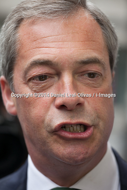 Ngel Farage deliver speech after significant gains. The leader of UKIP party Nigel Farage talks with the media before giving a party speech in central London after his significants gains in the European and Council elections. InterContinental Hotel, London, United Kingdom. Monday, 26th May 2014. Picture by Daniel Leal-Olivas / i-Images