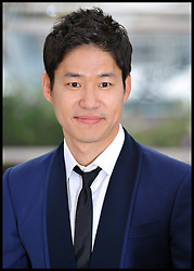 Yu Junsang pose's for Photographers during the Photocall for the film In Another Country during 65th Annual Cannes Film Festival at Palais des Festivals, Cannes, France, Monday May 21, 2012. Photo by Andrew Parsons/i-Images.