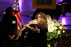 20 November 2015. Orpheum Theater, New Orleans, Louisiana. <br /> Memorial service for musician Allen Toussaint. <br /> Ben Jaffe of Preservation Hall Jazz band consoles friends in front of Toussaint's casket.<br /> Photo; Charlie Varley/varleypix.com