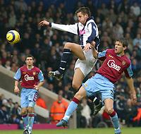 Photo: Dave Linney.<br />West Bromwich Albion v Aston Villa. The Barclays Premiership. 02/01/2006West Brom's Darren Carter (L) leaps in front of  Eirik  Bakke