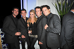 Centre, ZOE SALMON with band BLAKE (OLLIE BAINES, HUMPHREY BERNEY, JULES KNIGHT and STEPHEN BOWMAN) at a photographic retrospective showcasing images from Guess's historic advertising campaigns held at Il Bottaccio, Grosvenor Place, London on 28th October 2009.