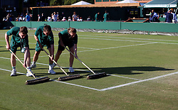 Members of the ground staff sweep a court on day eight of the Wimbledon Championships at the All England Lawn Tennis and Croquet Club, Wimbledon. PRESS ASSOCIATION Photo. Picture date: Tuesday July 10, 2018. See PA story TENNIS Wimbledon. Photo credit should read: Nigel French/PA Wire. RESTRICTIONS: Editorial use only. No commercial use without prior written consent of the AELTC. Still image use only - no moving images to emulate broadcast. No superimposing or removal of sponsor/ad logos. Call +44 (0)1158 447447 for further information.