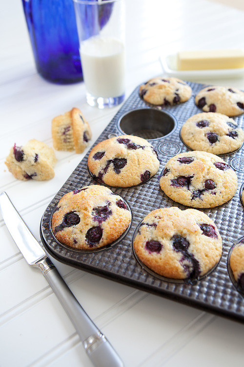 Blueberry Corn Muffins in an antique muffin tin.