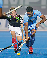 BHUBANESWAR  (INDIA)  - HERO Champions Trophy Hockey men. Day 1. Germany vs India.  Mats Grambusch of Germany\ (l) and Dharamvir Singh of India. PHOTO  KOEN SUYK