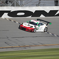 January 06, 2018 - Daytona Beach, Florida, USA:  The Wright Motorsports Porsche 911 GT America races through the turns at the Roar Before The Rolex 24 at Daytona International Speedway in Daytona Beach, Florida.