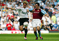 Photograph: Scott Heavey.<br />Aston Villa V Liverpool. FA Barclaycard Premiership match from Villa Park. 24/08/2003.<br />Harry Kewell (L) and Peter Whittingham battle for the ball.