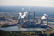 Plant Bowen is the third-largest  generator of electricity in the United  States, producing more than 22 million  megawatt hours per year and emitting  20.5 million tons of CO2 and 900 pounds  of mercury each year