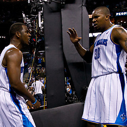 November 17, 2010; New Orleans, LA, USA; New Orleans Hornets point guard Chris Paul (3) celebrates with teammate power forward David West (30) after scoring during the second half against the Dallas Mavericks at the New Orleans Arena. The Hornets defeated the Mavericks 99-97. Mandatory Credit: Derick E. Hingle