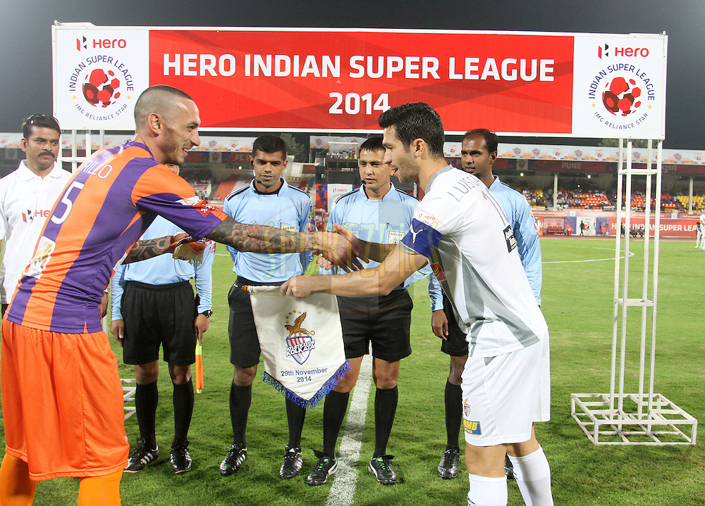 Bruno Cirillo of FC Pune City and Luis Javier Garcia Sanz of Atletico de Kolkata  during the toss of the match 44 of the Hero Indian Super League between FC Pune City and Atletico de Kolkata FC held at the Shree Shiv Chhatrapati Sports Complex Stadium, Pune, India on the 29th November 2014.<br /> <br /> Photo by:  Vipin Pawar/ ISL/ SPORTZPICS