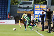 Sean Rigg of AFC Wimbledon battles Mitchell Rose during the Sky Bet League 2 match between Mansfield Town and AFC Wimbledon at the One Call Stadium, Mansfield, England on 5 September 2015. Photo by Stuart Butcher.