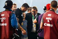 New Zealand Head Coach Steve Hansen looks on as Sonny Bill Williams helps up a young boy who is tackled by security after New Zealand win the match 34-17 to become 2015 World Cup Champions. He later gives the boy his World Cup Winners Medal - Mandatory byline: Rogan Thomson/JMP - 07966 386802 - 31/10/2015 - RUGBY UNION - Twickenham Stadium - London, England - New Zealand v Australia - Rugby World Cup 2015 FINAL.