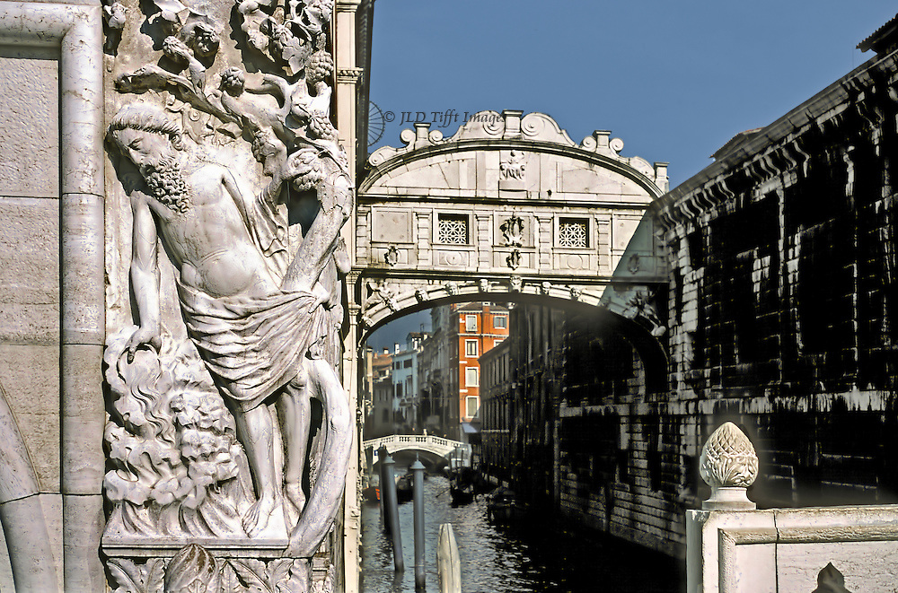 Drunkenness of Noah, early 15th century relief sculpture on corner of the Doges' Palace, Venice; Bridge of Sighs in the background; seen from Ponte della Paglia.