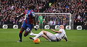 Pape Souare winches in agony from Jonjo Shelvey's challenge during the Barclays Premier League match between Crystal Palace and Swansea City at Selhurst Park, London, England on 28 December 2015. Photo by Michael Hulf.
