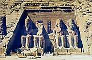 Sandstone statues of Rameses (Ramses) II (ruled c1304-c1273 BC) outside entrance to main temple at Abu Simbel (Abu Sunbul). Temple dedicated to sun gods Amon-Re and Re-Horakhte.  Not known outside Egypt in modern times until 1813 and explored in 1817 by Belzoni.