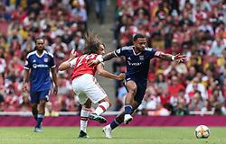 Matteo Guendouzi of Arsenal and Memphis Depay of Lyon tussle for the ball - Mandatory by-line: Arron Gent/JMP - 28/07/2019 - FOOTBALL - Emirates Stadium - London, England - Arsenal v Olympique Lyonnais - Emirates Cup