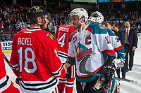KELOWNA, CANADA - APRIL 14: Matt Revel #18 of the Portland Winterhawks shakes hands with Rodney Southam #17 of the Kelowna Rockets on April 14, 2017 at Prospera Place in Kelowna, British Columbia, Canada.  (Photo by Marissa Baecker/Shoot the Breeze)  *** Local Caption ***