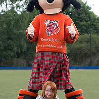 Perth Kilt Run 2013....Picture by Graeme Hart.<br /> Abbie pictured with the Perth Kilt Run mascot and a bottle of Highland Spring water, one of the event sponsors<br /> Copyright Perthshire Picture Agency<br /> Tel: 01738 623350  Mobile: 07990 594431