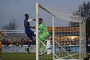 close Sutton United Goalkeeper Ross Worner (1) and AFC Wimbledon striker Tom Elliott (9) watch as the ball nearly crosses the line during The FA Cup match between Sutton United and AFC Wimbledon at Gander Green Lane, Sutton, United Kingdom on 7 January 2017. Photo by Stuart Butcher.