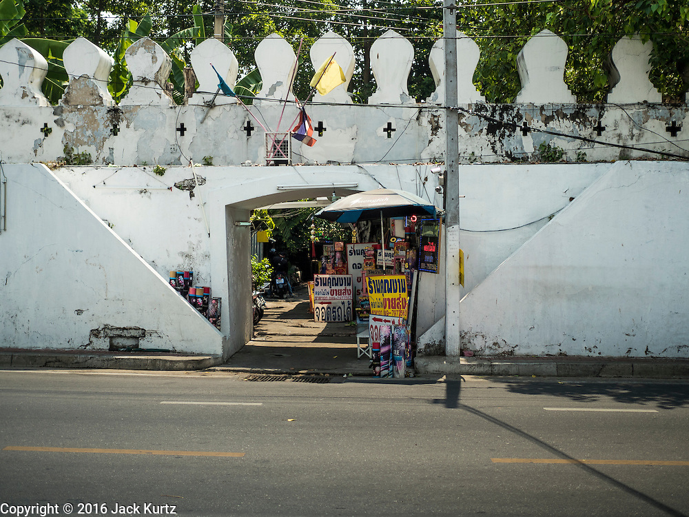07 APRIL 2016 - BANGKOK, THAILAND: An entrance to Mahakan Fort. The community is known for fireworks, fighting cocks and bird cages. Mahakan Fort was built in 1783 during the reign of Siamese King Rama I. It was one of 14 fortresses designed to protect Bangkok from foreign invaders, and only of two remaining, the others have been torn down. A community developed in the fort when people started building houses and moving into it during the reign of King Rama V (1868-1910). The land was expropriated by Bangkok city government in 1992, but the people living in the fort refused to move. In 2004 courts ruled against the residents and said the city could take the land. The final eviction notices were posted last week and the residents given until April 30 to move out. After that their homes, some of which are nearly 200 years old, will be destroyed.       PHOTO BY JACK KURTZ
