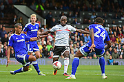 Fulham FC forward Sone Aluko (24) makes his way through Cardiff defence during the EFL Sky Bet Championship match between Fulham and Cardiff City at Craven Cottage, London, England on 20 August 2016. Photo by Jon Bromley.