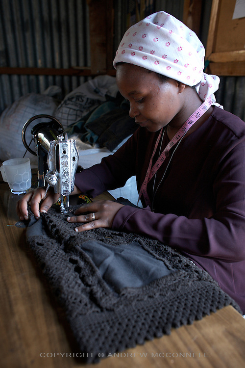 "A handmade crochet shoulder-bag produced by the Totoknits group is finished by lining the inside; pictured in the Dagoretti area of Nairobi, Kenya, in Monday, Jan. 12, 2009. The Totoknits group consists of 150 women who produce some of the crochet hand-bags, cases and scarfs for MAX&Co. The products are part of the company's ""ethical fashion"" range in Africa which is designed to reduce extreme poverty and empower women. The limited edition collection consists of one-of-a-kind handmade accessories such as shoulder-bags, bracelets, key-rings, belts and scarfs."