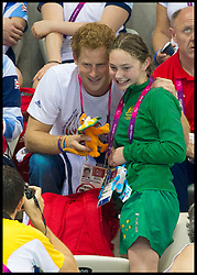 Prince Harry with an AUSTRALIAN COMPETITOR and Team GB Members at the Aquatics Centre at the London 2012 Paralympics Games, Tuesday September 2012. Photo By i-Images